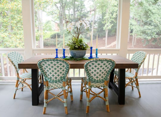 A dining table in the covered porch space designed b Frances Kinloch Still