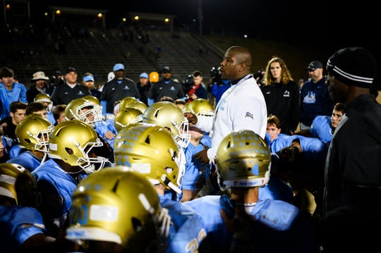 Daniel head coach Jeff Fruster speaks with his team after their game against Ridge View Friday, Nov. 22, 2019.