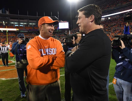 Clemson coach Dabo Swinney meets with South Carolina coach Will Muschamp at midfield during pregame in 2018 at Clemson's Memorial Stadium.