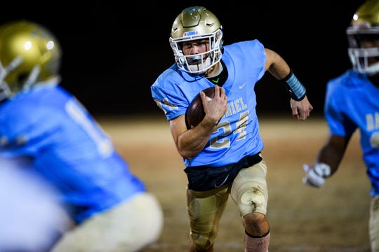 Daniel's Tyler Venables (24) attempts to advance during their game against Ridge View Friday, Nov. 22, 2019.