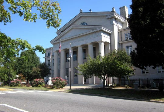 The 1921 classic revival Lincoln County Courthouse sits in the middle of the town's commercial historic square.