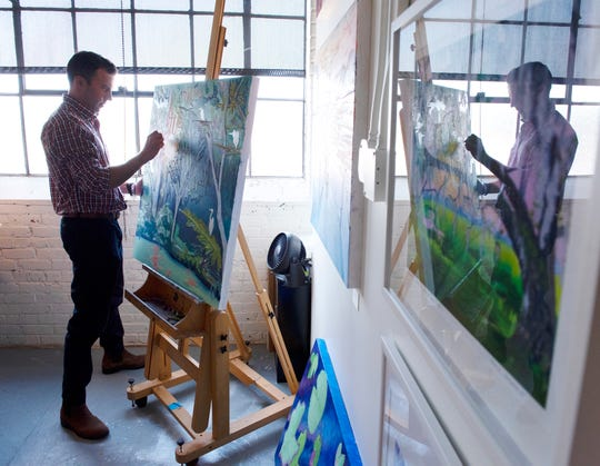 Craig Ragsdale works in his studio at the Greenville Center for Creative Arts in the West Village.