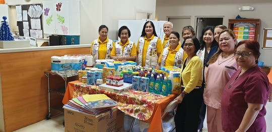 Guamerica Lions Club donated and filled the wish list of Guma Ginefli'e Dementia Day Care on Nov. 20. Standing from left: Secretary Cielo de los Reyes; Past President Tessie Marcos; President Rowena S. B. Guerrero; Vice President Edward O. Guerrero; PP Annie V. Payne, membership director; Past District Governor, Melen P. Ruiz, Evelyn O. Cruz, House Manager; Treasurer Daisy A. Cruz, Staff Member Sabre Garcia;  Rowena Baltazar, staff; and Veronica Hidrosollo, staff.