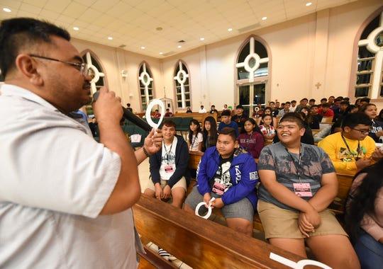 Kevin Delgado, the programs director at Santa Teresita Catholic Church, guides students during a CCD activity in Mangilao, Nov. 22, 2019.