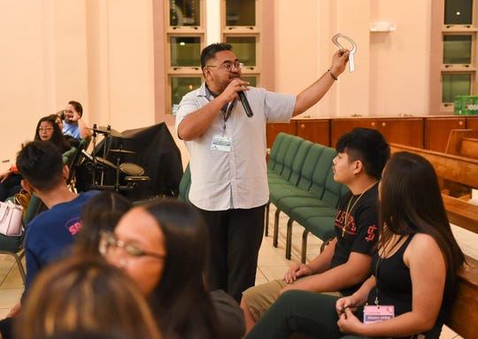 Kevin Delgado, the programs director at Santa Teresita Catholic Church, instructs students to write down what they are thankful for during a CCD activity in Mangilao, Nov. 22, 2019.