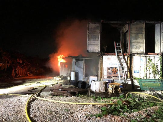 Firefighters extinguish a blaze that involved multiple shipping containers at the GreenGuam Recycling on Friday, Nov. 22, 2019.