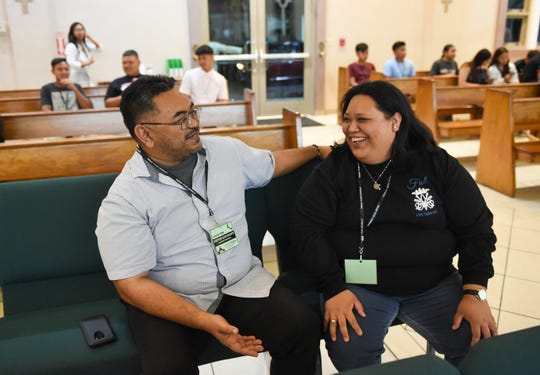 Kevin Delgado, Santa Teresita Catholic Church programs director, and Life Teen core member Kristine Bamba Borja share a laugh at their church in Mangilao, Nov. 22, 2019.