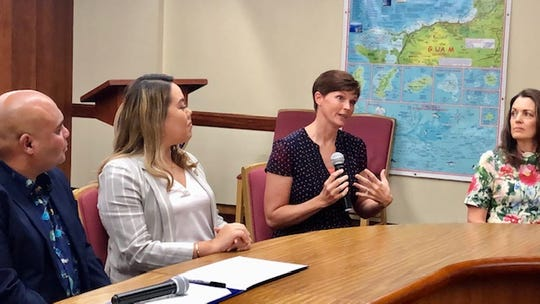 Ohala' Adoptions director Traci Anderson, second from right, gestures as she talks about the recent birth of Guam's first nonprofit adoption service as Acting Gov. Josh Tenorio, Sen. Amanda Shelton, and Ohala' Adoptions executive director Lori Boss look on, during the Nov. 22, 2019 signing at Adelup of a proclamation declaring Nov. 23 as National Adoption Day and November as National Adoption Month.