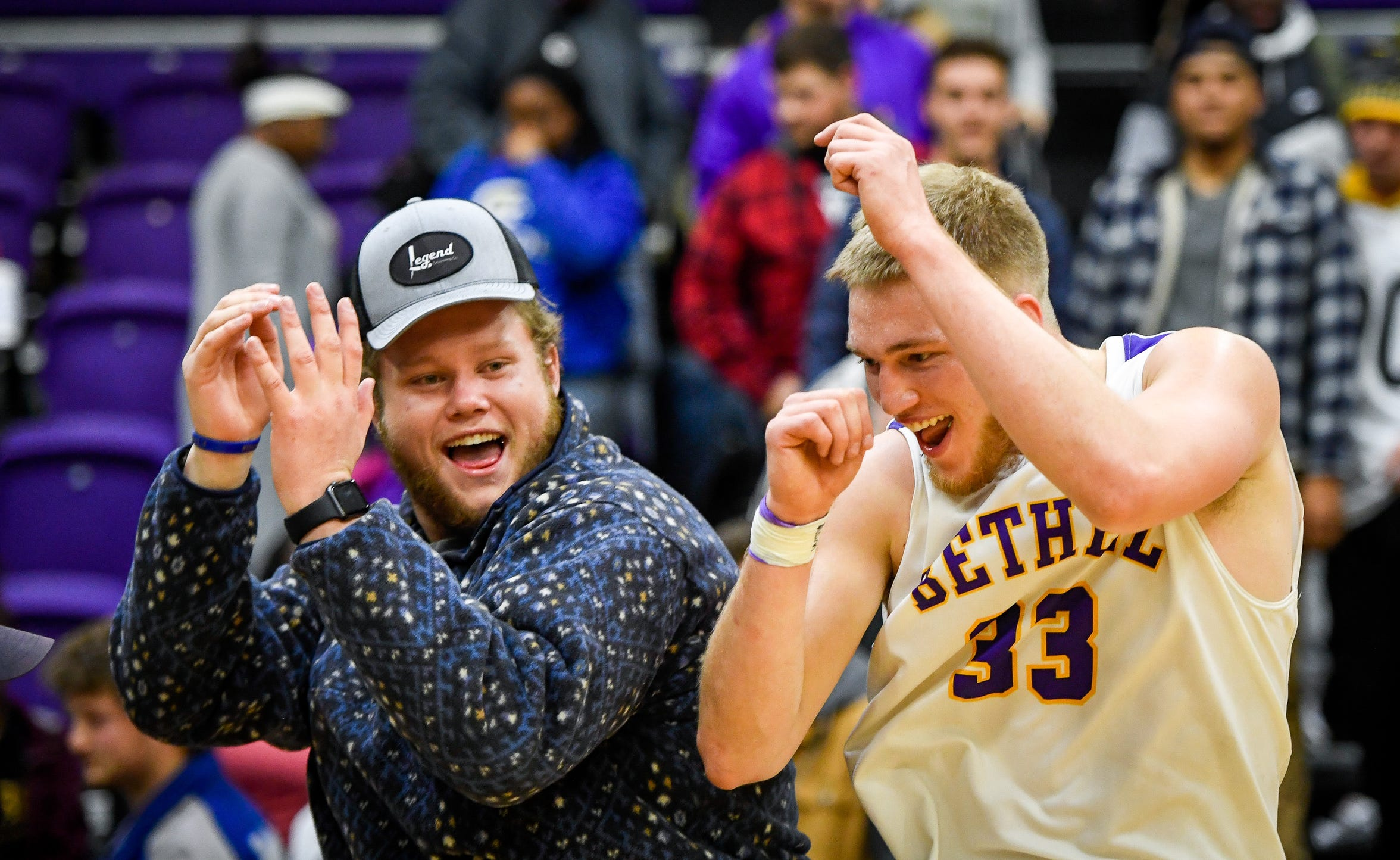 Cayden Edmonson celebrates with Bethel football player Trace Pierce after defeating rival the Freed-Hardeman Lions 84-75 at Bethel's Crisp Arena Thursday evening, November 14, 2019.
