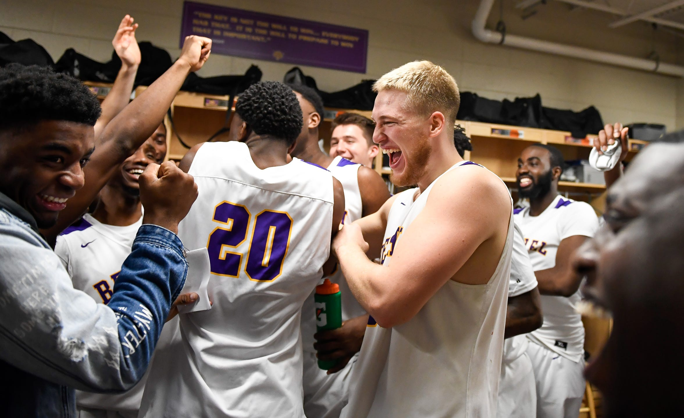 Celebration in the locker room, after being down by double digits at the half, Cayden Edmonson celebrates with his teammates after posting an 84-75 win over rival the Freed-Hardeman Lions at Bethel's Crisp Arena Thursday evening, November 14, 2019.