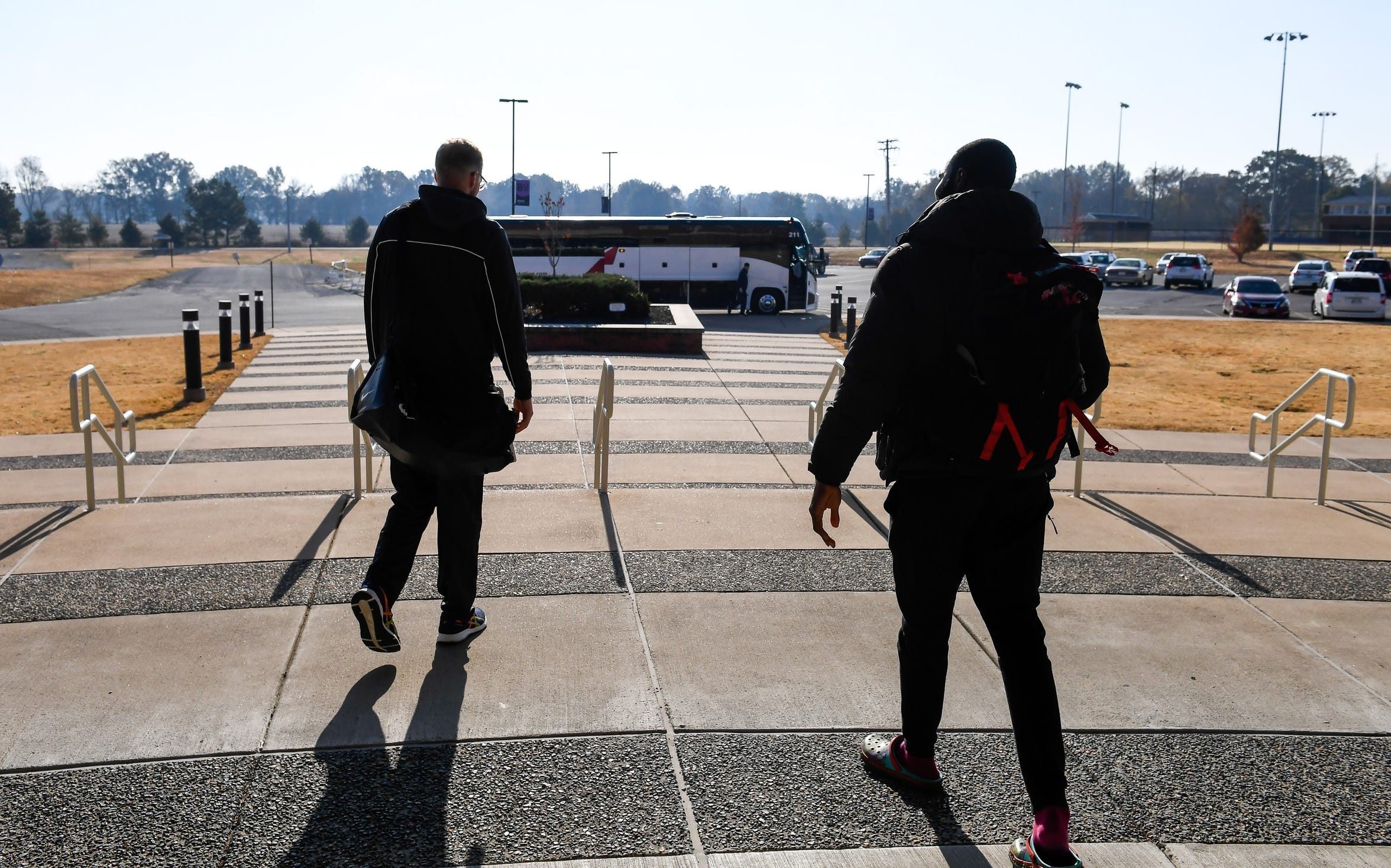 Leaving from Bethel University's Crisp Arena, Cayden Edmonson, left, along with his teammates, prepare to board a bus for a morning ride to Belleville, Ill., to play a road game with Lindenwood-Belleville Friday, November 15, 2019.