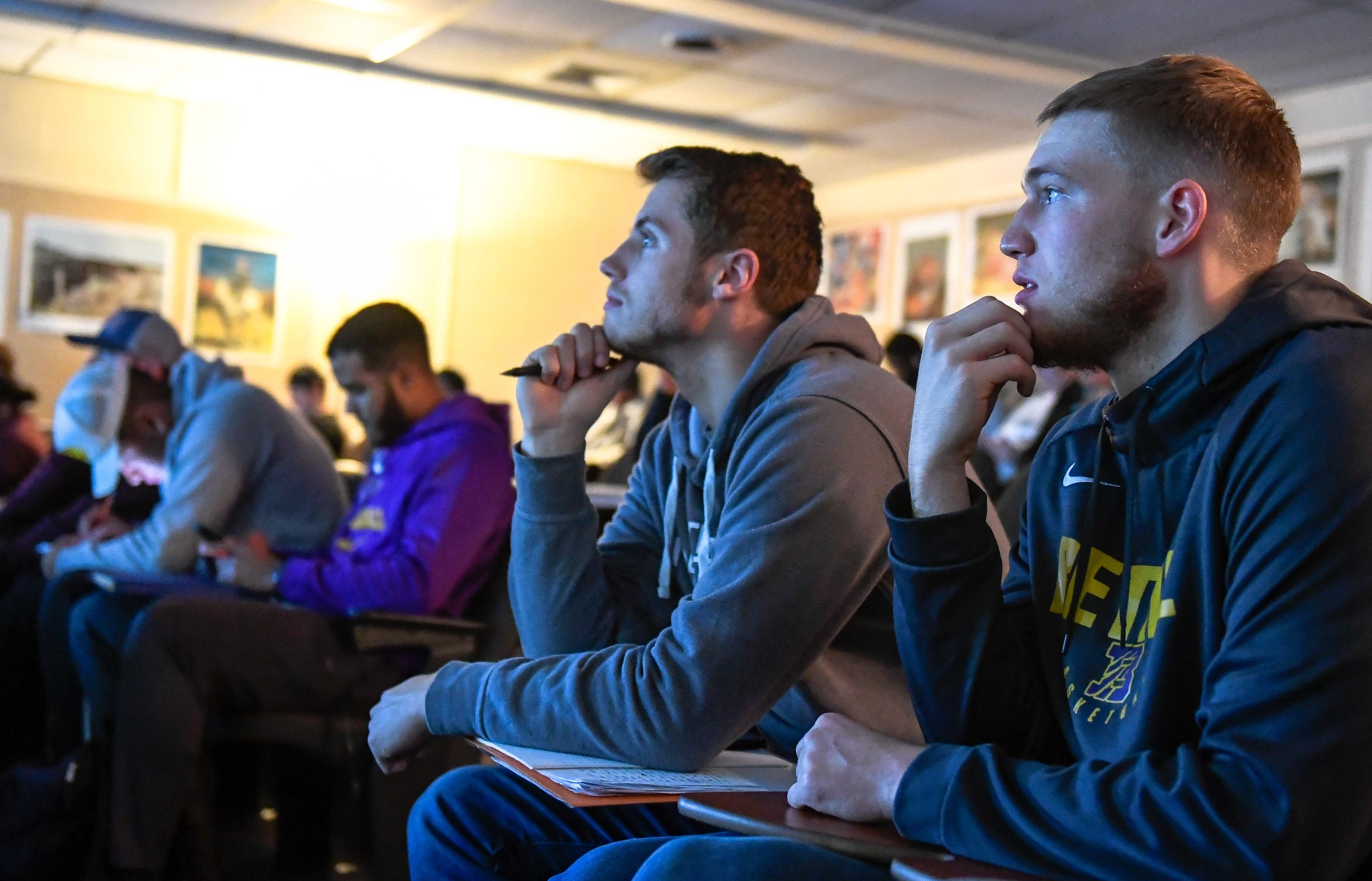 Cayden Edmonson, right, along with teammate Jake Rose concentrate during a western civilization lecture at Bethel University Thursday afternoon, November 14, 2019.