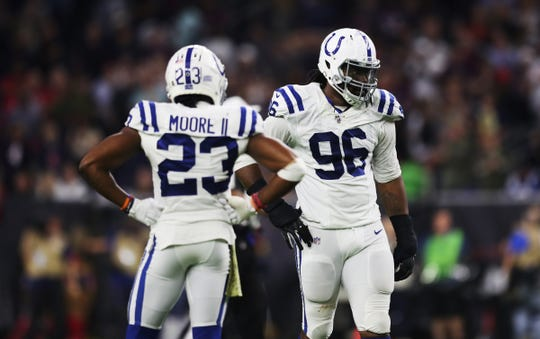 Indianapolis Colts cornerback Kenny Moore (23) and teammate defensive tackle Denico Autry (96) after the fourth quarter of the game against the Houston Texans at NRG Stadium in Houston, Texas on Thursday, Nov. 21, 2019. The Colts lost, 17-20.