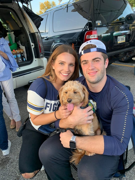 Notre Dame long snapper John Shannon, shown with sister Erin and the family labradoodle, Lucy,  has the ideal personality for his very important, anonymous role at Notre Dame.