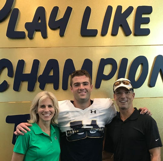 Notre Dame long snapper John Shannon with his parents Lisa and Gerard