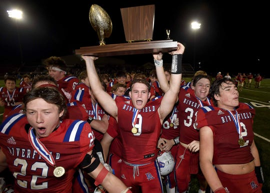 The Riverfield Academy Raiders celebrate with the Class 4A trophy after beating Tri-County Academy, 29-21, at the MAIS State Football Championships on Thursday, November 21, 2019, at Jackson Academy in Jackson, Miss.
