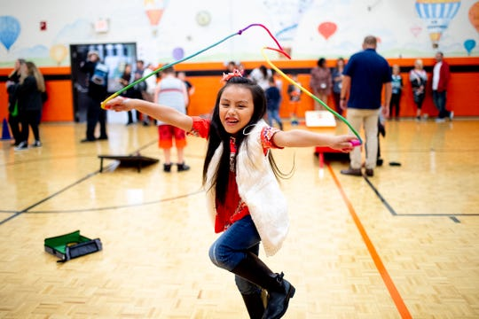 Valerie Mata, 6, jumps rope at Knoxville International Network's first Community Thanksgiving Potluck Dinner at Powell Elementary School in Powell, Tenn. on Thursday, Nov. 21, 2019. The faith-based Christian non-profit works to welcome people from other countries.