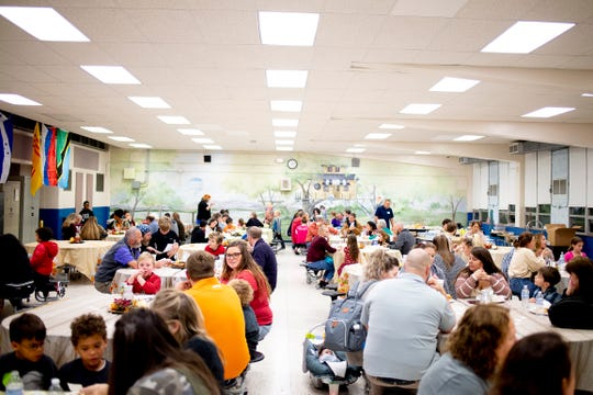 Attendees fill the cafeteria at Knoxville International Network's first Community Thanksgiving Potluck Dinner at Powell Elementary School in Powell, Tenn. on Thursday, Nov. 21, 2019. The faith-based Christian non-profit works to welcome people from other countries.