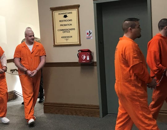 Garett Kirts, left, walks to the courtroom in the Newton County Courthouse on Friday, Nov. 22, 2019. Kirts has been charged with murder in the March 29 death of Nicole Bowen, a 30-year-old mother of two from West Lafayette.