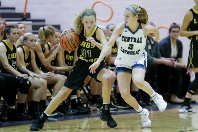 Benton Central's Tressa Senesac (31) shakes off Central Catholic's Caroline Lutz (2) during the fourth quarter of game eight in the 2019 Girls Hoops Classic, Thursday, Nov. 21, 2019 in West Lafayette.