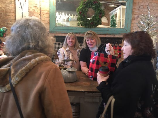 Like Mother Like Daughter Vintage Treasures co-owners Jordan Wester (left) and Jada Wester celebrate the recent expansion of their downtown Howell shop at a ribbon cutting event, Friday, Nov. 22, 2019.