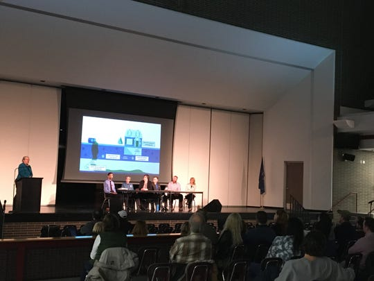 Lisa Quiggle (far left), toxicologist with the Michigan Department of Health and Human Services, speaks during a public meeting Thursday Nov. 21, 2019 at Parker Middle School in Howell about a trichloroethylene leak that occurred from Howell-based company Diamond Chrome Plating.