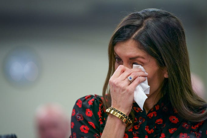 Kirsten Russell, whoÕs mother was was killed during an act of domestic gun violence, wipes tears from her eyes as she speaks during an Interim Joint Judiciary Committee Meeting of the Kentucky Legislature addressing extreme risk protection orders at the Capitol Annex in Frankfort, Ky., Saturday, Jun 2, 2019.