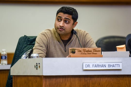 Trustee Dr. Farhan Bhatti voices his disagreement with outgoing Lansing School District Superintendent Yvonne Caamal Canul's comments about a woman who accused Mark Coscarella of sexual harassment during a Lansing School District Board of Education meeting on Thursday, Nov. 21, 2019, at the Shirley M. Rodgers Administration Building in Lansing.