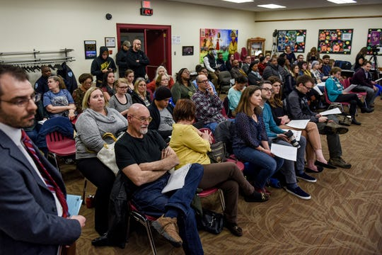 Attendees listen during a Lansing School District Board of Education meeting on Thursday, Nov. 21, 2019, at the Shirley M. Rodgers Administration Building in Lansing. The meeting was the first after acting Superintendent Mark Coscarella was placed on paid administrative leave leave while officials investigate a sexual harassment claim made against him.