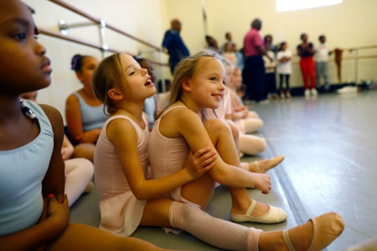 Twin sisters, Libby, left, and Louise Behnke, 7, watch their fellow dancers as the New Ballet Ensemble prepares for their performance of 'Nut Remix', a take on the traditional holiday Nutcracker, from their Cooper Young studio on Saturday, Nov. 9, 2019.