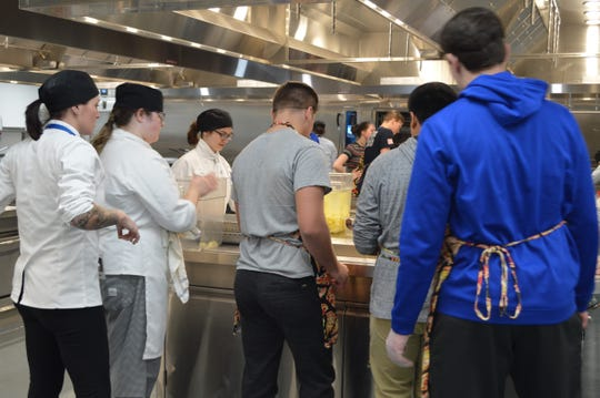 Waukesha County Techincal College and Kettle Moraine High School students made 25 meals for families in need on Nov. 20.