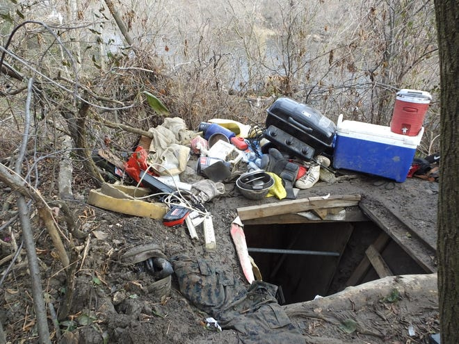 A grill and other supplies were pulled from an underground bunker near the Milwaukee River. Geoffrey Graff's bunker was found Nov. 20 after he was arrested for firing a gun into the river.