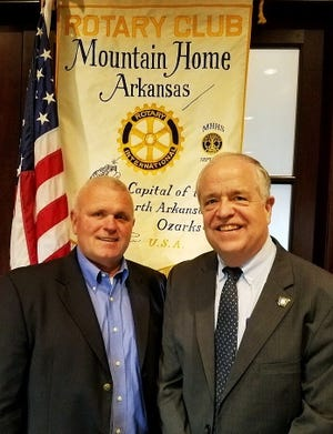 On Thursday, Nov. 21, Mountain Home Rotarian of the Day Steve Litty brought a program from the Arkansas State Police with Colonel Bill Bryant. Also attending the meeting were Rotarian/MH Mayor Hillrey Adams, MH Police Chief Carry Manuel, ASP Trooper First Class Rodney Villiger, Major Charles Hubbard, and Trooper/pilot Barry Saffold. Mark Hopper was the lucky winner of the American Wheelchair Mission delivery trip to Jamaica in March, compliments of Dave and Judy Matty. Pictured above are Rotarian Steve Litty (left) and Arkansas State Police Colonel Bill Bryant (right).