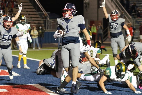 West Monroe senior H-back Cayden Pierce (1) strolls into the end zone during the Class 5A second round playoff game versus Captain Shreve Thursday night at Rebel Stadium.