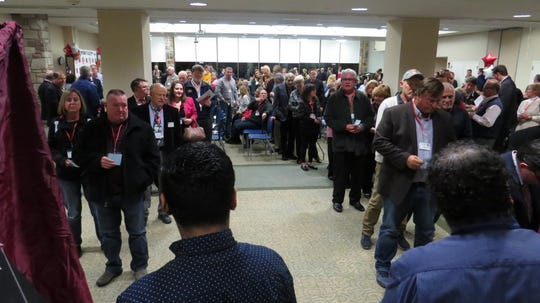 District 25 Republican Committee members line up to vote for a candidate to temporarily fill the seat of former Assemblyman, now Sen. Anthony M. Bucco, during a District 25 Republican convention at the County College of Morris in Randolph. Nov. 21, 2019.