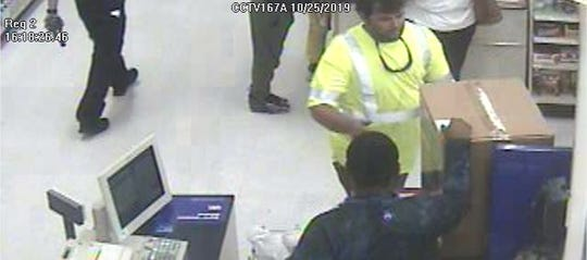 The man in the reflective shirt is being sought by Prattville police for passing a counterfeit $100 bill