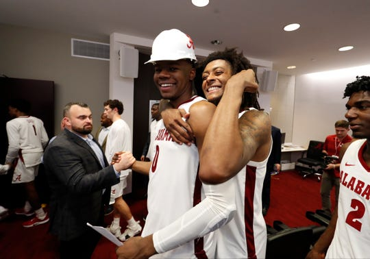 Alabama junior wing John Petty Jr. celebrates with redshirt freshman forward Javian Davis (0) in the team film room after Davis was named the hard-hat player of the game following a 81-73 win over Furman on Nov. 19, 2019 inside Coleman Coliseum in Tuscaloosa, Ala. (Photo by Robert Sutton/Alabama athletics)