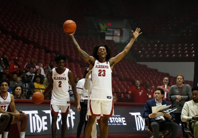 Alabama junior wing John Petty Jr. (23) reacts to a teammate's dunk during the annual Tide TipOff event Oct. 18, 2019 inside Coleman Coliseum in Tuscaloosa, Ala. (Photo by Robert Sutton/Alabama athletics)