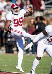 Alabama kicker Ty Perine (99) punts against Mississippi State at Davis Wade Stadium on the MSU campus in Starkville, Ms., on Saturday November 16, 2019.