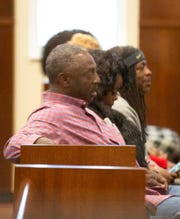 The family of Greg Gunn sits in the courtroom as a guilty verdict is read on a charge of manslaughter against officer A.C. Smith.