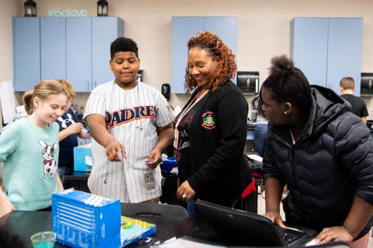 Felicia Reed-Kidd looks over her sixth grade class's hands-on ecosystem project at Joelton Middle School on Nov. 22, 2019.