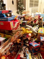 Tim Davis' annual Christmas party brings in hundreds of toys for the Last Minute Toy Store.