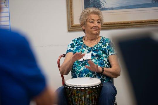 Mary-Rina Longo participates in a drum circle class, Thursday, Nov. 21, 2019, at the Naples Senior Center.