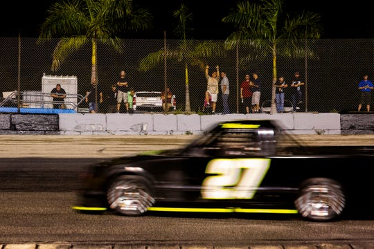 Fans watches the race as Cody Krucker races on the track on Saturday, September 14, 2019, at 4-17 Southern Speedway in Punta Gorda. Krucker finished in second place. Cody Krucker leads the season-long points standings and is going for the season title in the championship race November 30.