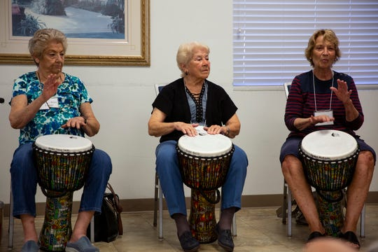 Mary-Rina Longo, left, Terry Butts and Carolyn Mulligan participate in a drum circle class, Thursday, Nov. 21, 2019, at the Naples Senior Center.