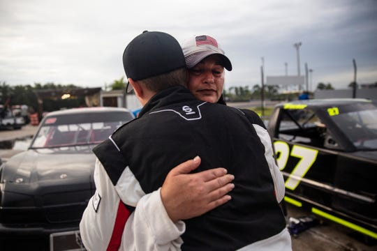 Cody Krucker, left, hugs his mother, Shannon Bullock, right, during the pro truck feature race on Saturday, September 14, at 4-17 Southern Speedway in Punta Gorda. Krucker finished in second place. Cody Krucker leads the season-long points standings and is going for the season title in the championship race November 30.