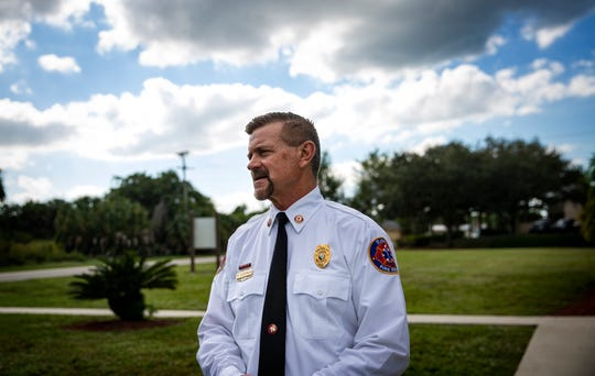 Estero Fire Department Chaplin Mark Goodman pauses in front of his church during an inteview, Tuesday, Nov. 19, 2019, at Christ Community Ministries in Estero.