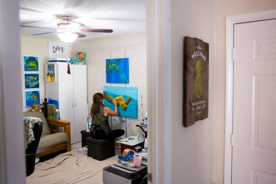"Dora Knuteson works on a painting at her home studio in Naples on Thursday, November 21, 2019. Knuteson says she's busier than ever after transitioning to painting full time, but she's glad to be able to raise money for causes she cares about. ""I'm doing something I love, and I'm making a difference,"" she said."