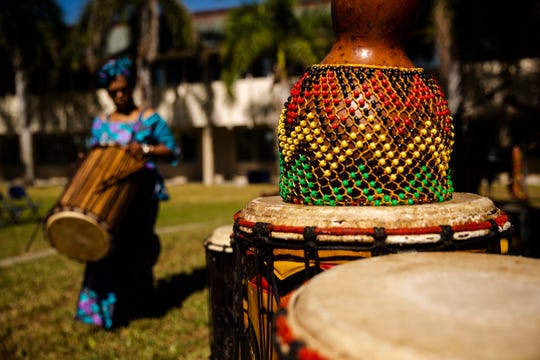 Natalie Jackson from Kuumba Dancers & Drummers carries a Dundun drum during the International Education Week on Thursday, November 21, 2019, at Florida SouthWestern State College in Fort Myers.