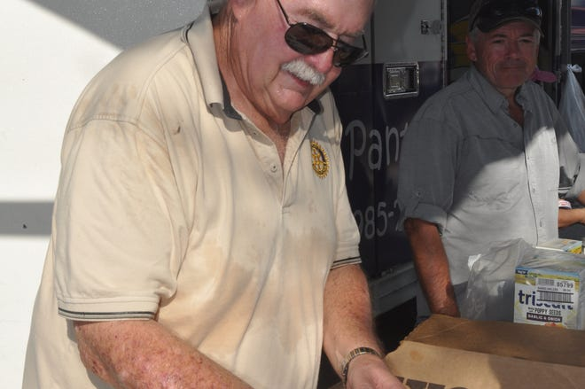 Millard Pray, a volunteer with the Rotary Club of Bonita Beach Sunset, distributes food with Meals of Hope. The nonprofit has started bringing its mobile food pantry to Bonita Springs on Wednesdays.
